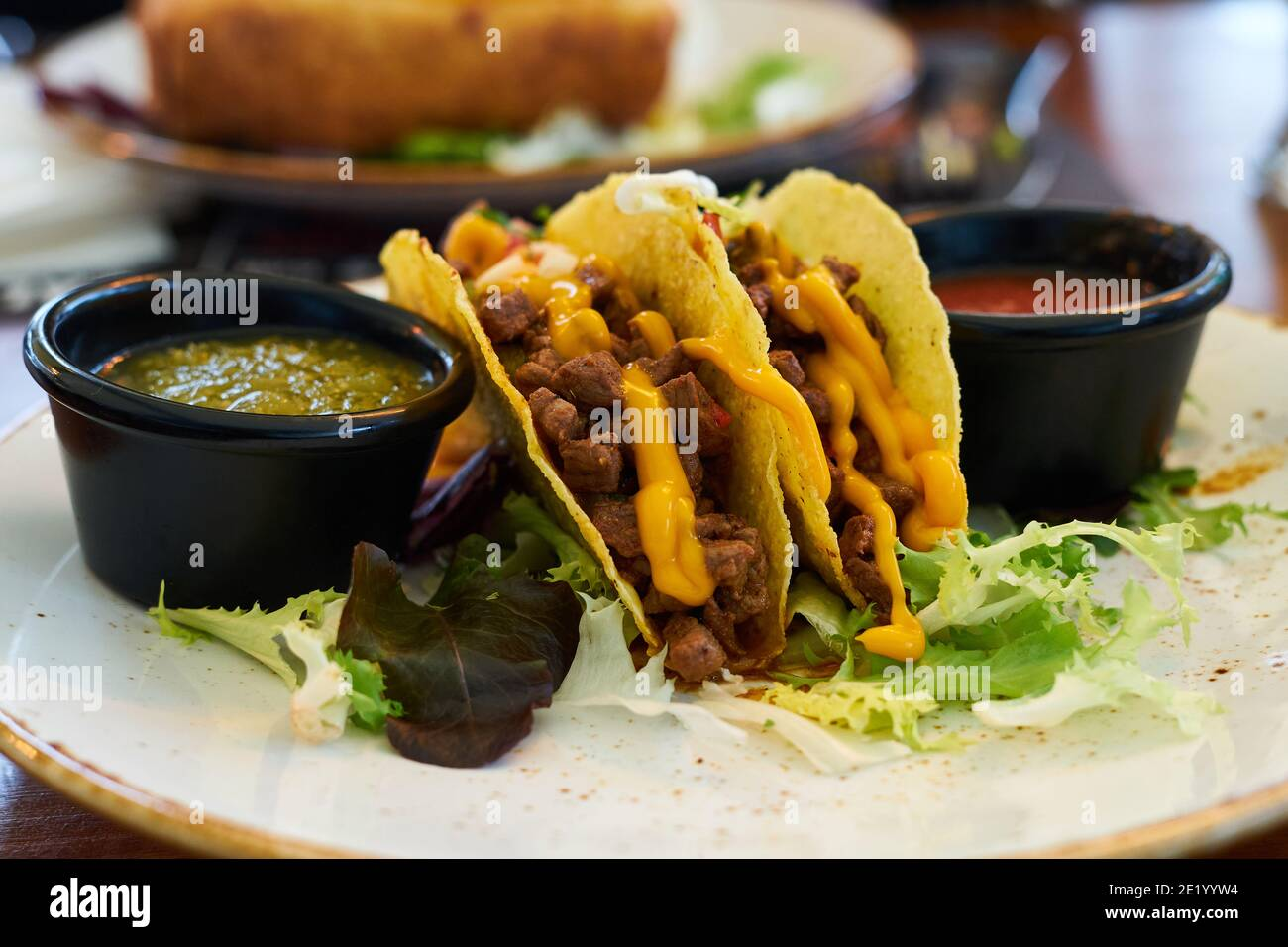 Mexican food, meat tacos with spicy sauces, selective focus Stock Photo