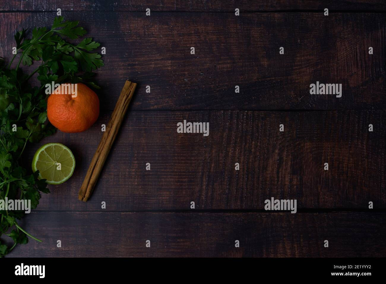 ingredients on wooden board, tangerine cinnamon parsley Stock Photo