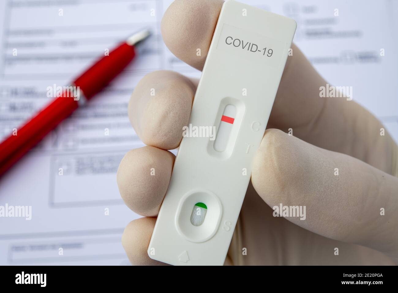 Covid-19, hand in glove and test sticks Stock Photo