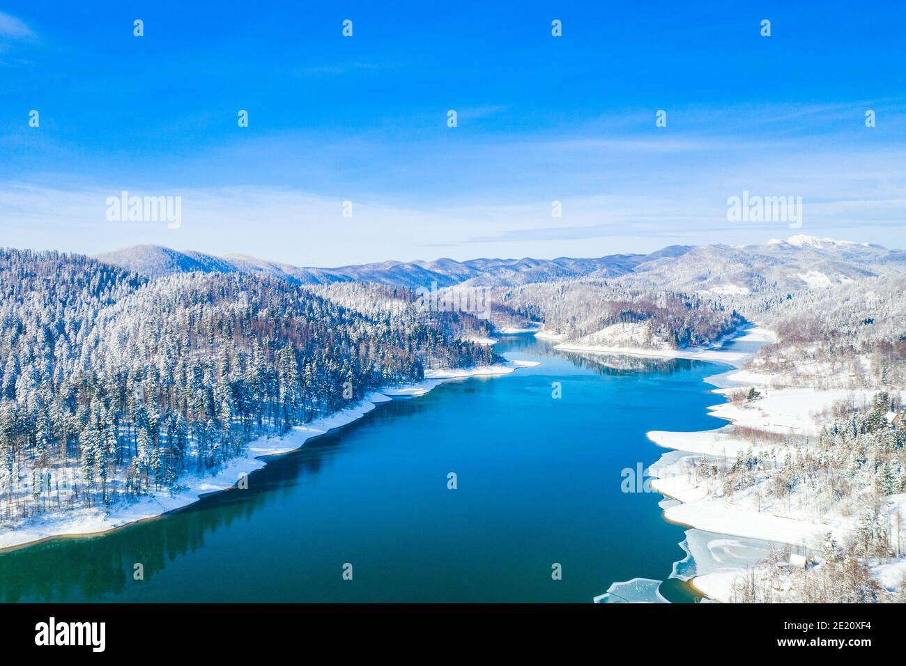 Beautiful showy winter landscape in Croatia. Panorama of Lokvarsko lake and in Gorski kotar from drone. Stock Photo