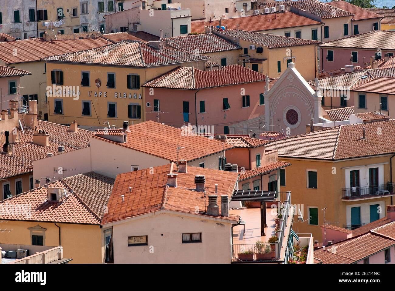 Portoferraio village with the top of the Nativity of the Blessed Virgin Mary Church standing out among the houses, Elba Island, Tuscany, Italy Stock Photo