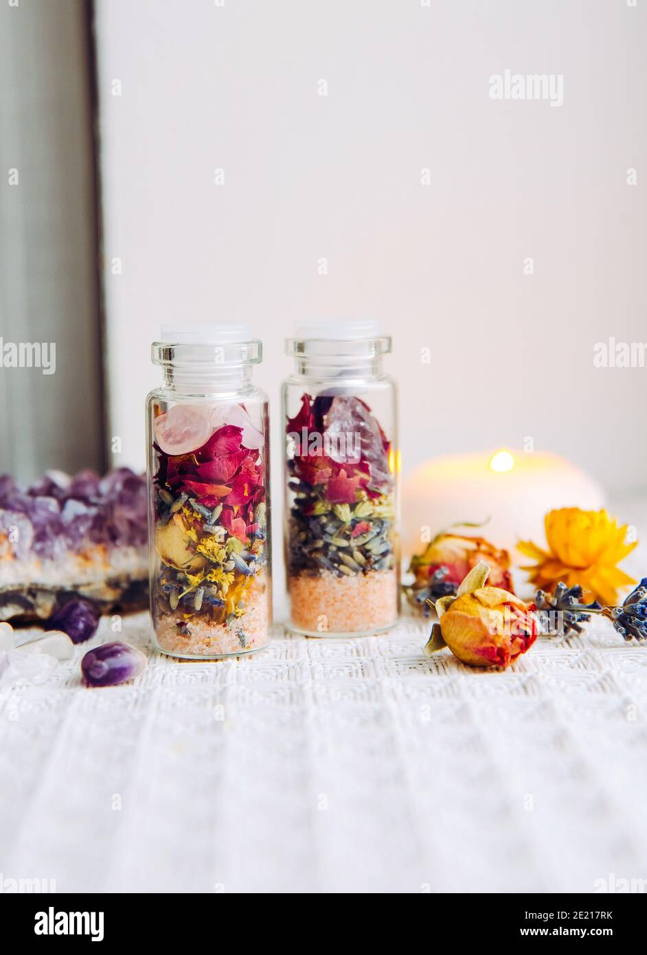 Handmade spell jar bottles with good intentions for home protection and inner balance. Filled with Himalayan rock salt, dried herbs flowers. Stock Photo
