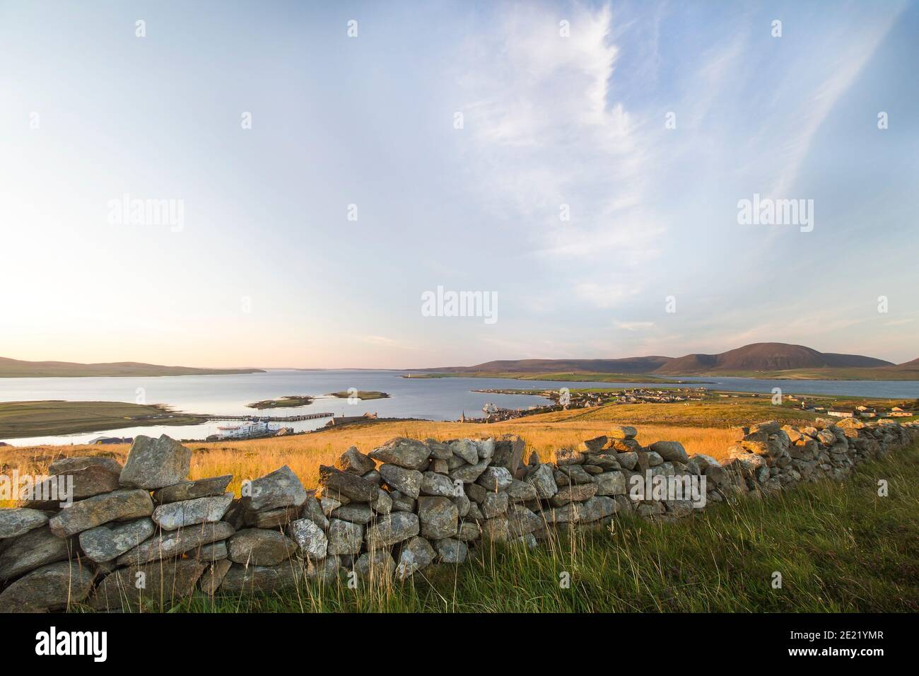 Aerial view of Stromness harbour on Orkney islands with drystone wall and grass in foreground Stock Photo