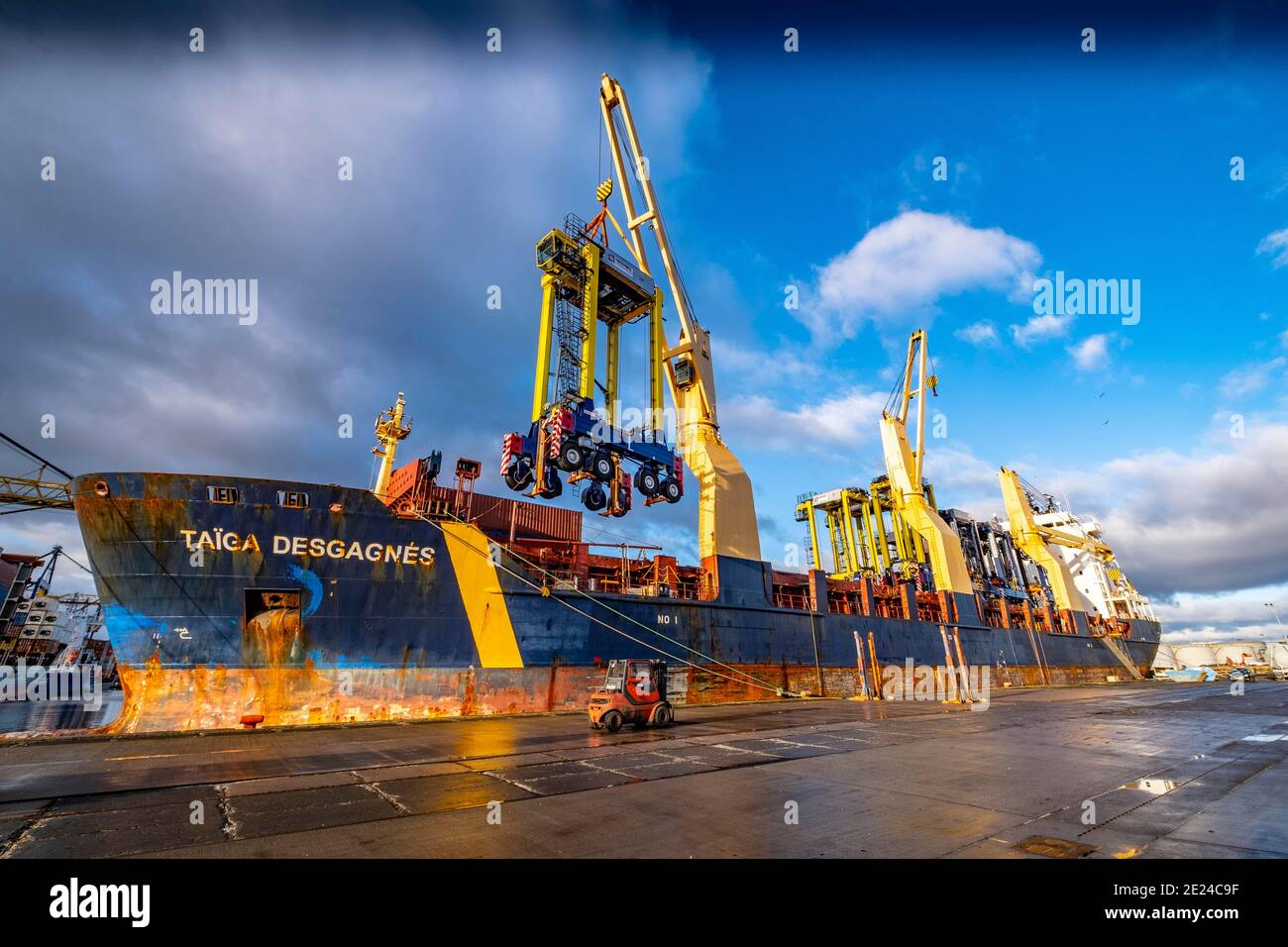 Straddle Carriers at dockside Stock Photo