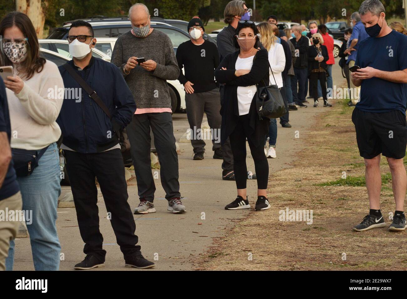 Los Angeles, California, USA. 13th Jan, 2021. Los Angeles, United States. 13th Jan, 2021. Residents wait in line to be inoculated with the Moderna COVID-19 vaccine at the Balboa Sports Center vaccination site in Los Angeles on Tuesday, January 12, 2021. People aged 65 and older and those with serious underlying health conditions in Los Angeles and across California could quickly become eligible for a COVID-19 vaccine, with federal officials urging states Tuesday to more widely distribute the shots. Photo by Jim Ruymen/UPI Credit: UPI/Alamy Live News Credit: UPI/Alamy Live News Stock Photo