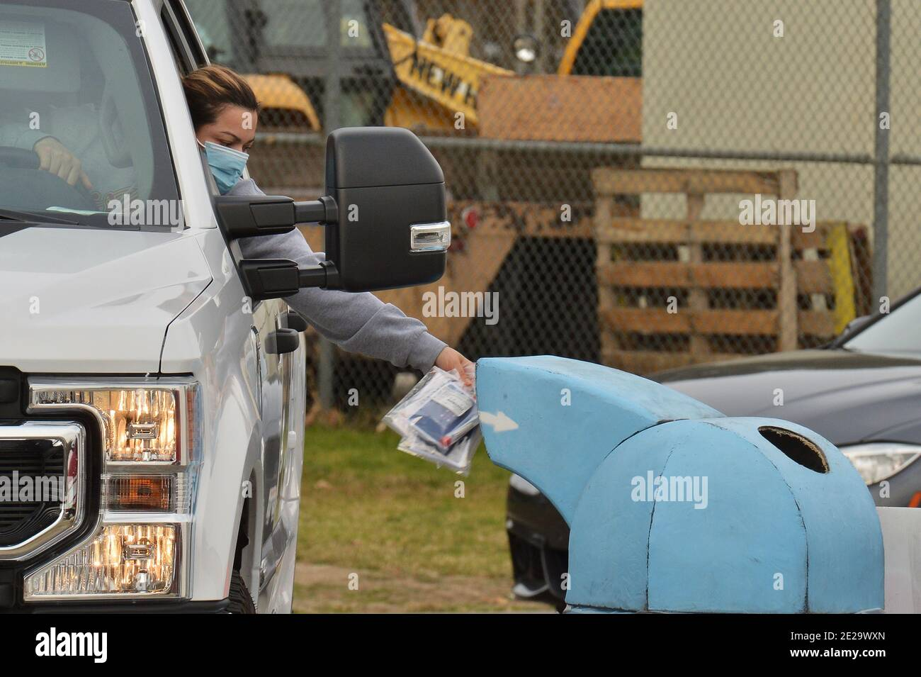 """Los Angeles, California, USA. 13th Jan, 2021. Los Angeles, United States. 13th Jan, 2021. Residents deposit their Curative coronavirus test in a receptacle at the Hansen Dam testing site in Los Angeles on Tuesday, January 12, 2021. Los Angeles County health officials said Sunday they will stop providing the commonly used coronavirus test after federal regulators raised questions about its accuracy, saying the test made by Curative carries a """"risk of false results, particularly false negative results."""" Photo by Jim Ruymen/UPI Credit: UPI/Alamy Live News Credit: UPI/Alamy Live News Stock Photo"""