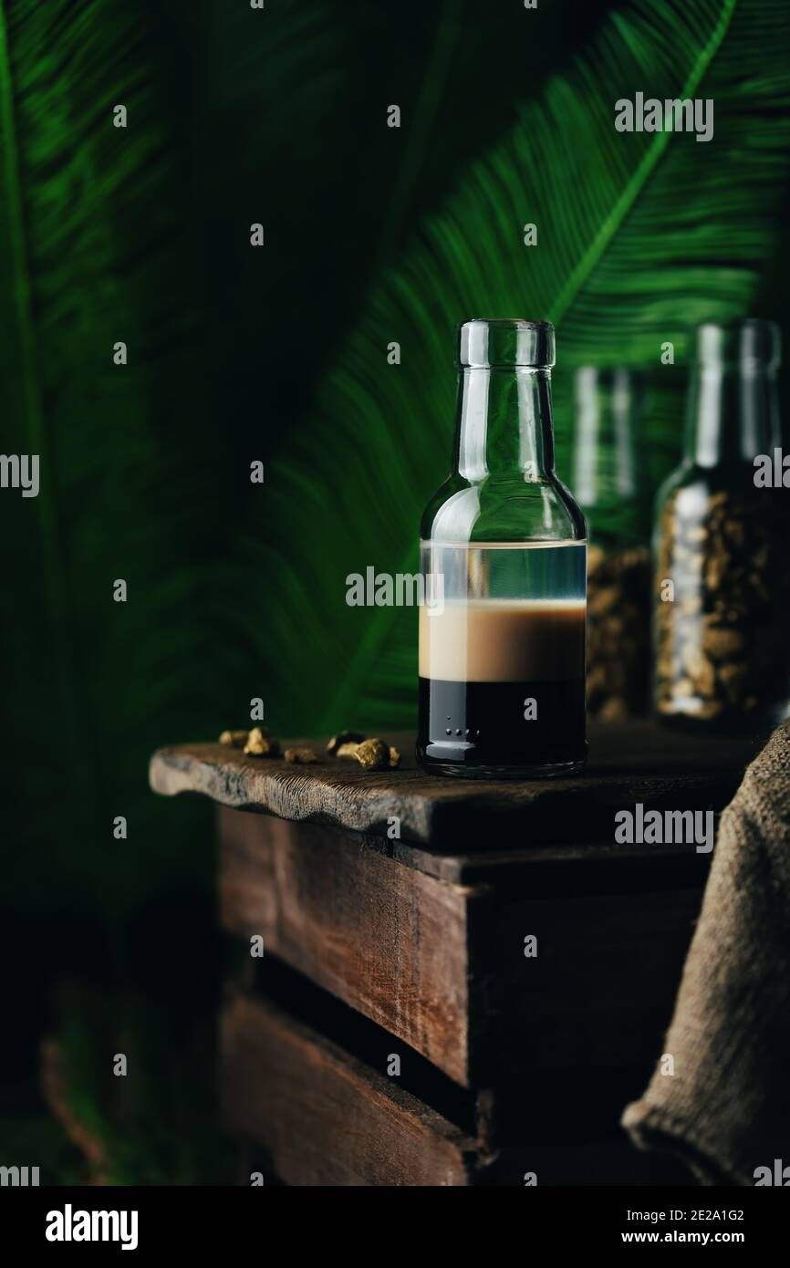 B-52 - layered cocktail with three liqueurs Kahlua, Baileys, Cointreau served in a small bottle. Stock Photo