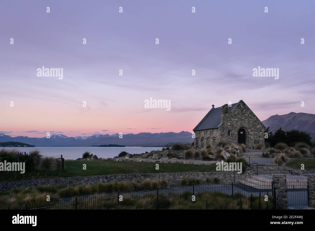 Historic Church of the Good Shepherd with amazing sunset landscape. Lake Tekapo, New Zealand. Stock Photo