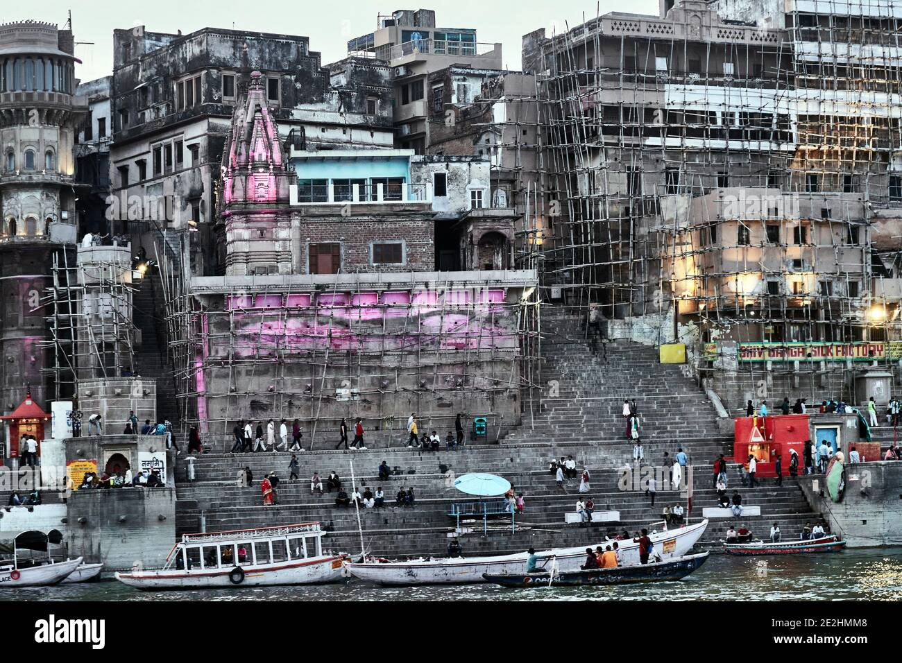 Varanasi (ex-Bénares), Uttar Pradesh, India. Restaurations of buildings are done in India with bamboo scaffolding. The Ganges River at Varanasi which Stock Photo