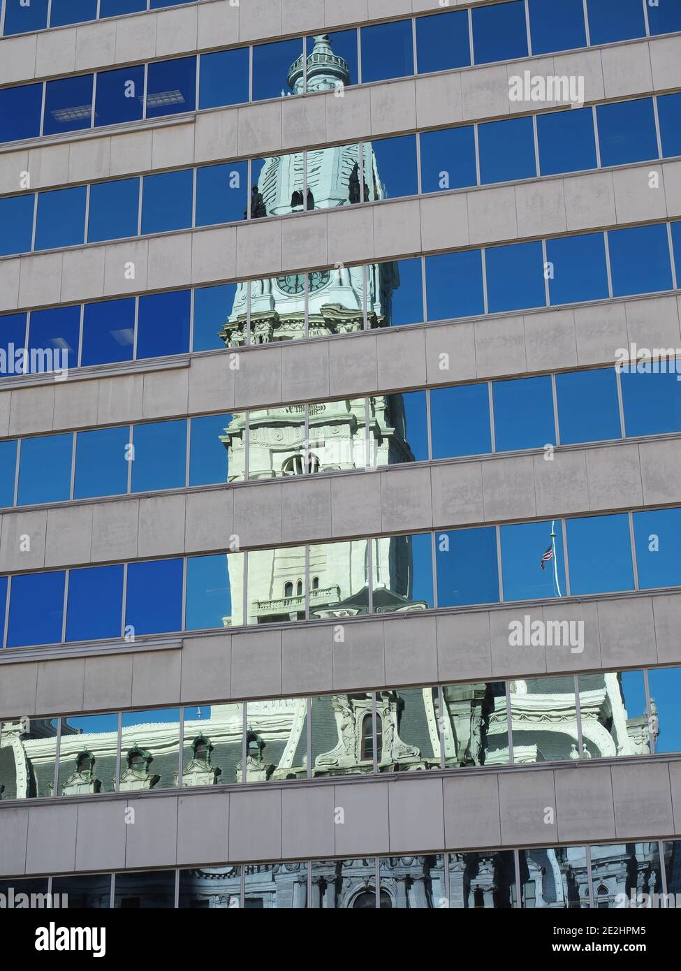 Image of the Philadelphia City Hall reflecting on nearby buildings. Stock Photo
