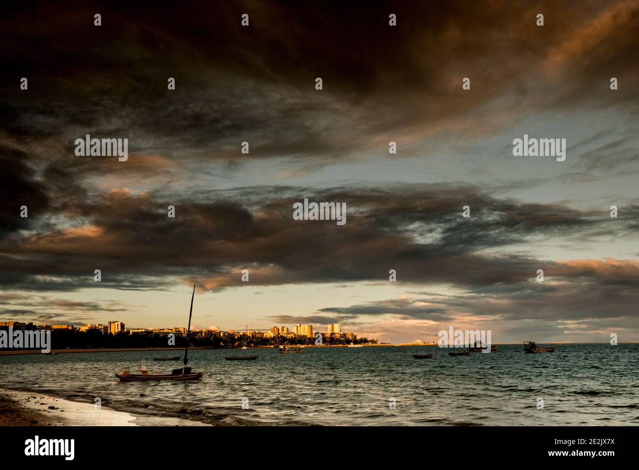 Sunset and tourist boats on a beach in Maceió, Brazil Stock Photo
