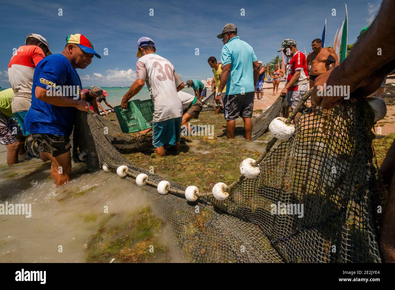 Fishermen working on a beach in Maceió, Brazil Stock Photo