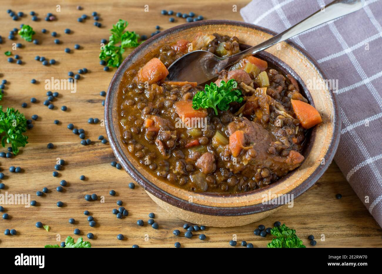 lentil soup with meat  in a bowl  on wooden background from above Stock Photo