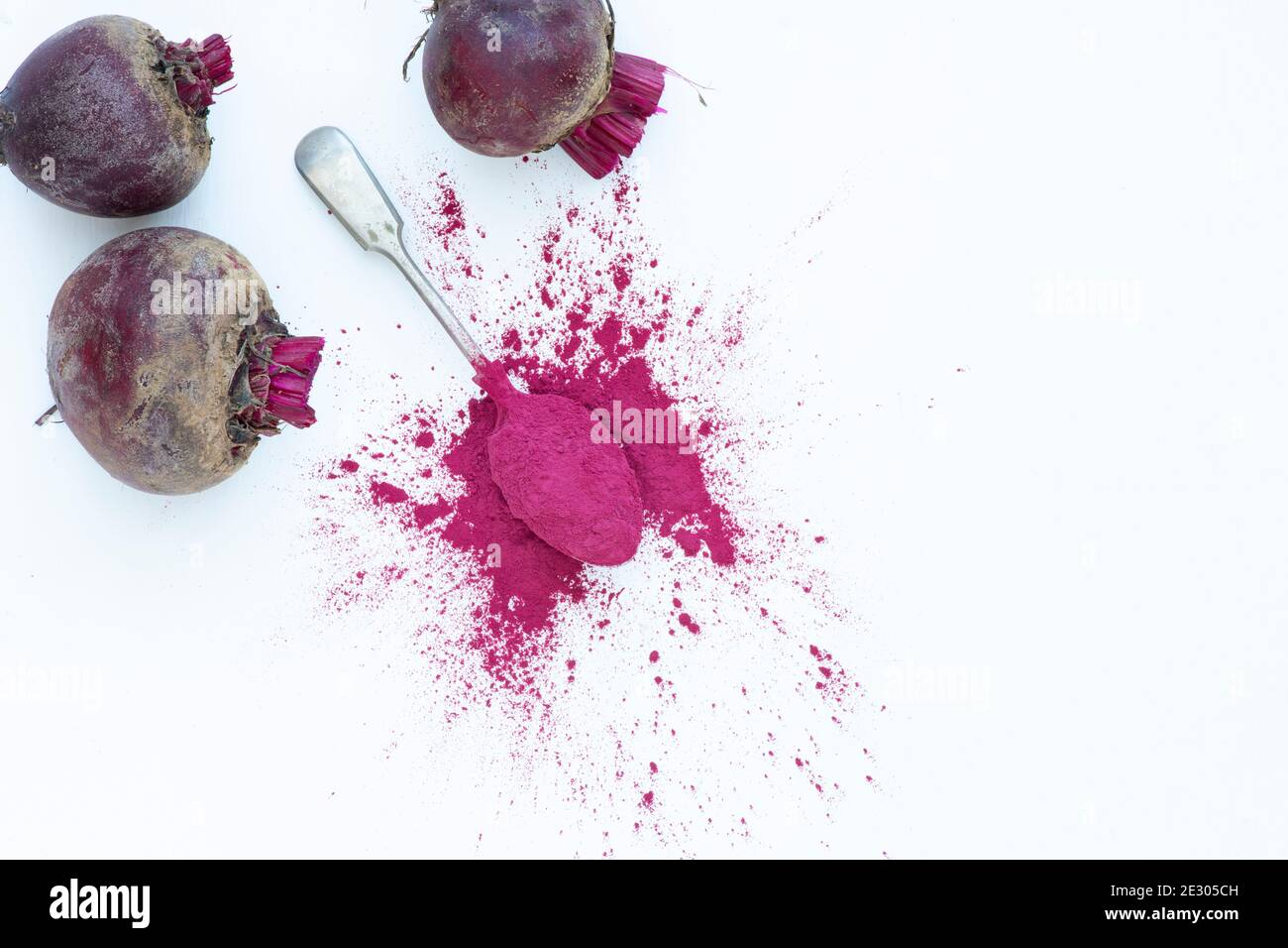 Beta vulgaris. Beetroot powder and beetroots Stock Photo