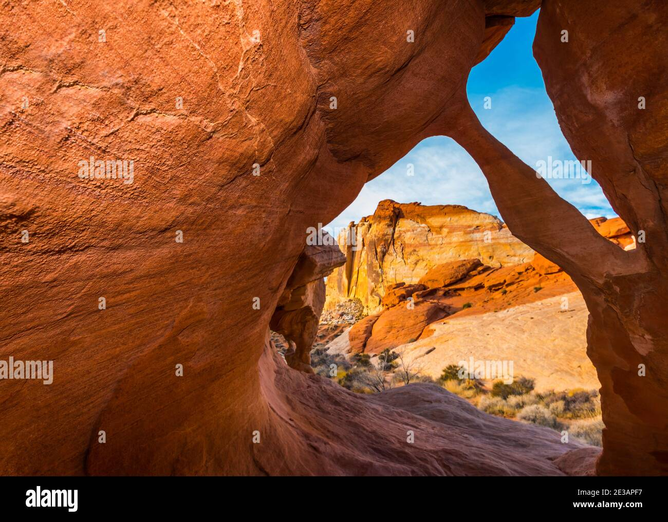 Fire Cave Arch With The White Domes in the Distance, Valley of Fire State Park, Nevada, USA Stock Photo