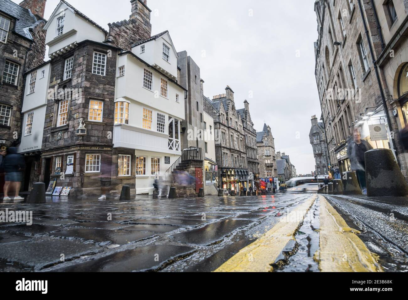 Ground level view looking down the Royal Mile Edinburgh, Scotland, showing John Knox House, on a rainy day Stock Photo
