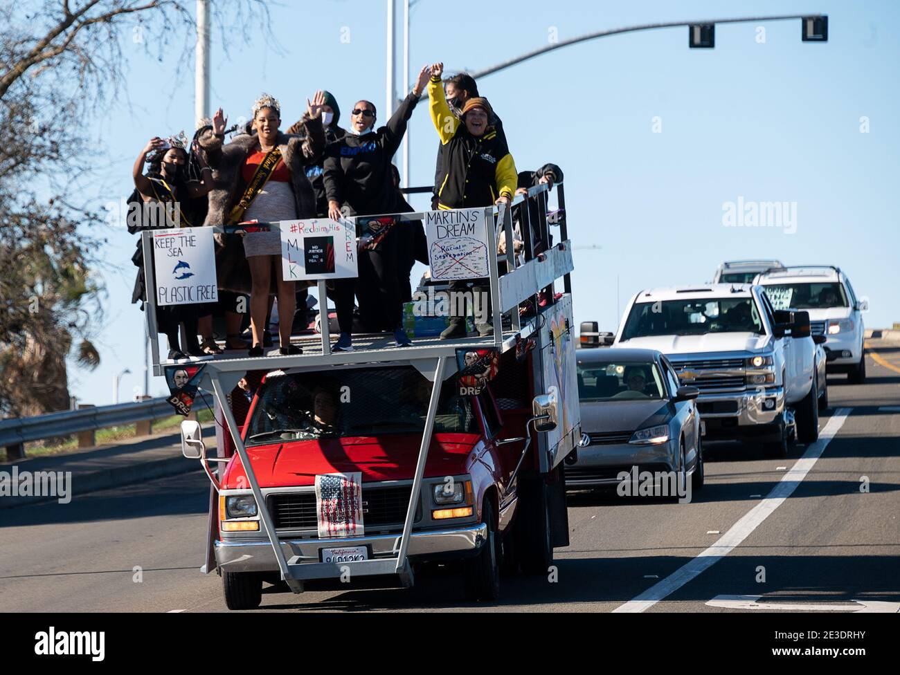 Sacramento, CA, USA. 18th Jan, 2021. 100Õs of cars leave Sacrament City College during the #ReclaimMLK Day car caravan in celebration of Martin Luther King Jr.Õs birthday sponsored by Black Lives Sacramento and NCAAP on Monday, Jan. 18, 2021 in Sacramento. Credit: Paul Kitagaki Jr./ZUMA Wire/Alamy Live News Stock Photo