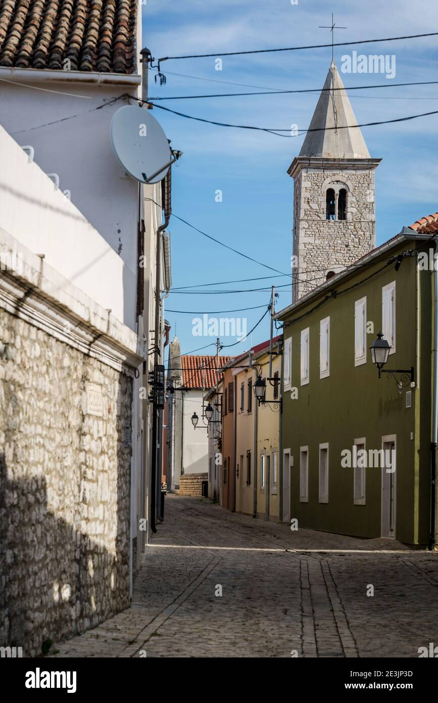 Street in Nin and Romanesque bell tower, a historic town in the Zadar County, Dalmatia, Croatia Stock Photo