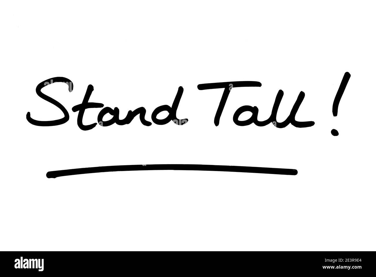 Stand Tall! handwritten on a white background. Stock Photo