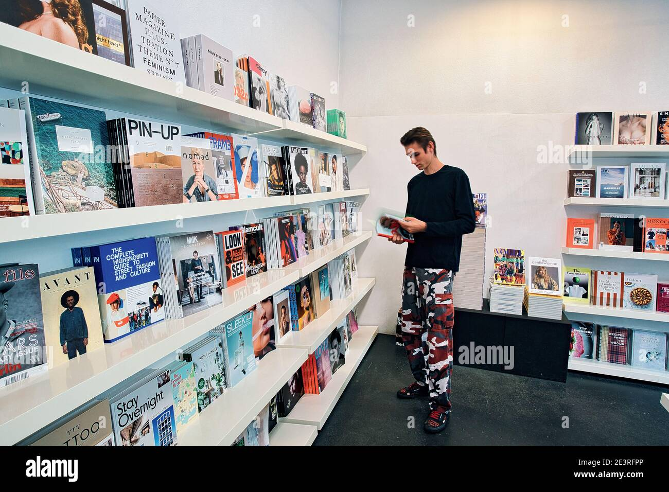 GERMANY / Munich /Bookstores/ Young man reading book in SODA ...