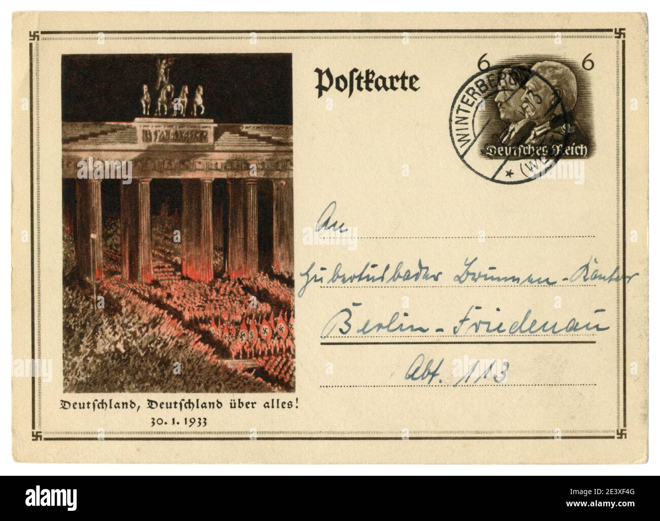 German historical postal card: Anniversary of the overthrow of power. SA troops pass by the Bradenburg gate. 30 january 1933, Germany, Third Reich Stock Photo