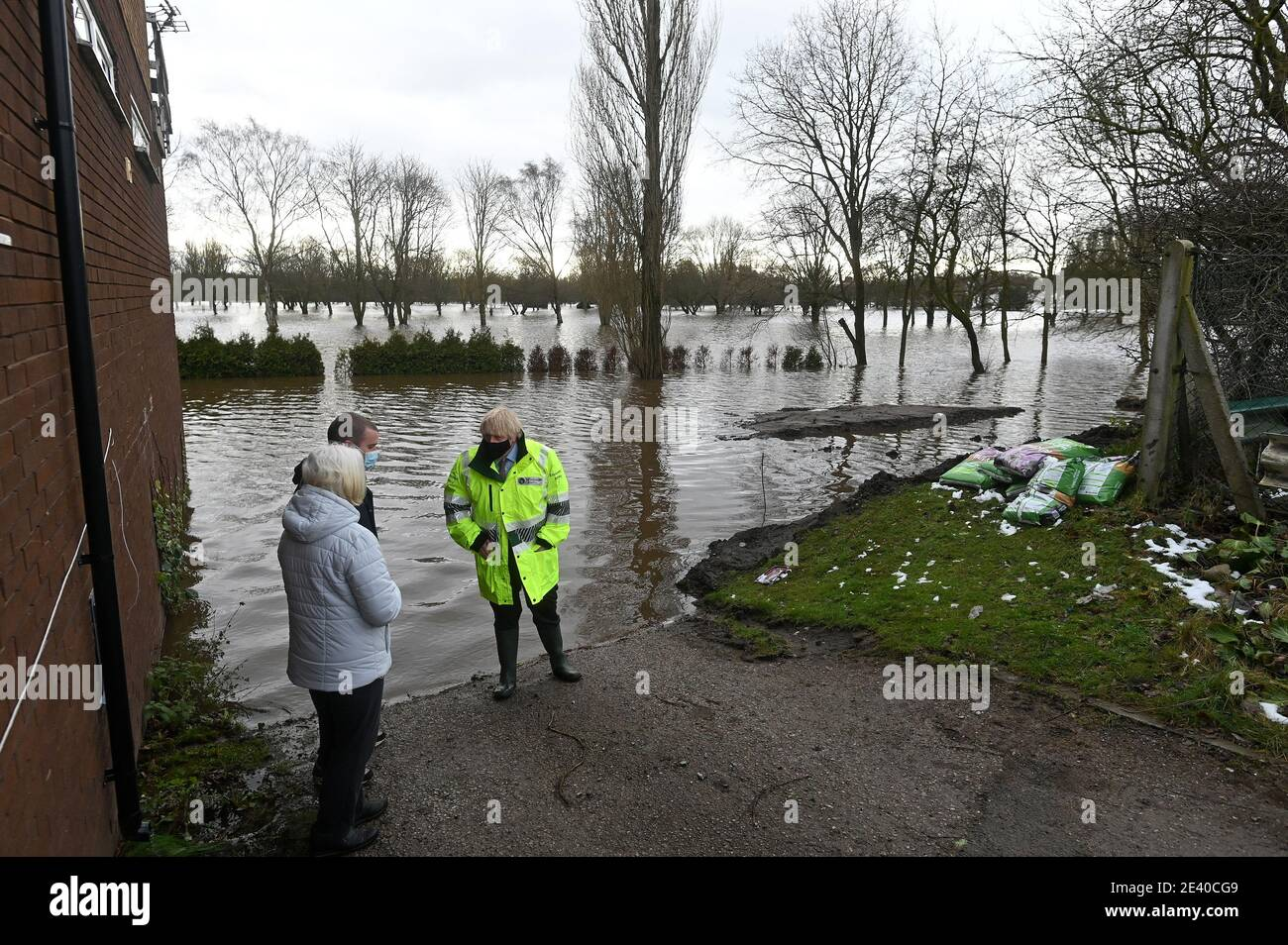 Britain's Prime Minister Boris Johnson talks with local residents during his visit to Withington in Manchester, as Storm Christoph brings heavy rains and flooding across the country, Britain January 21, 2021. Paul Ellis/Pool via REUTERS Stock Photo