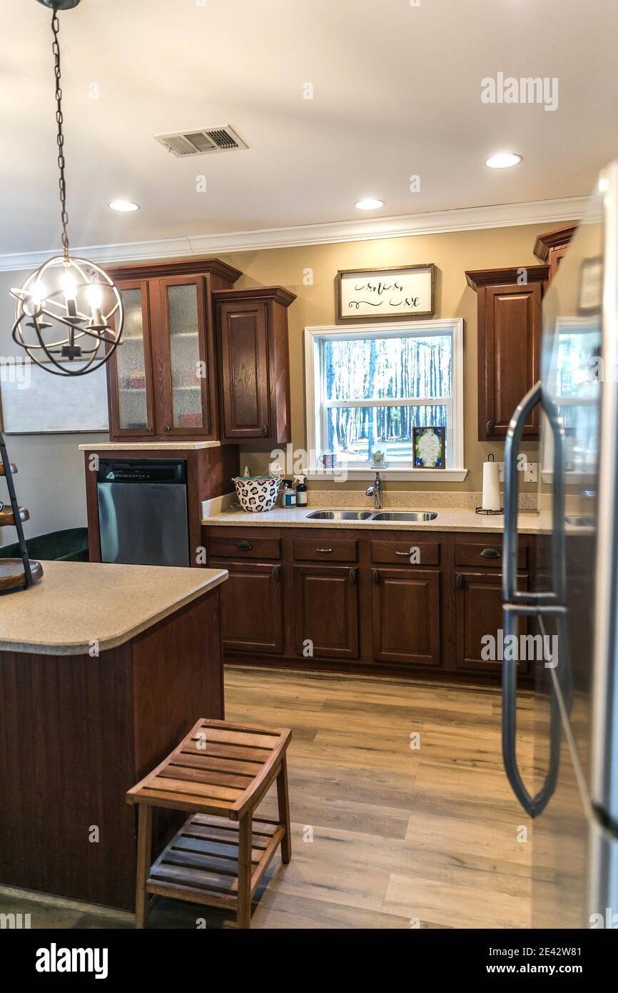 Small Renovated Dark Wood Kitchen With Center Island Stock Photo Alamy