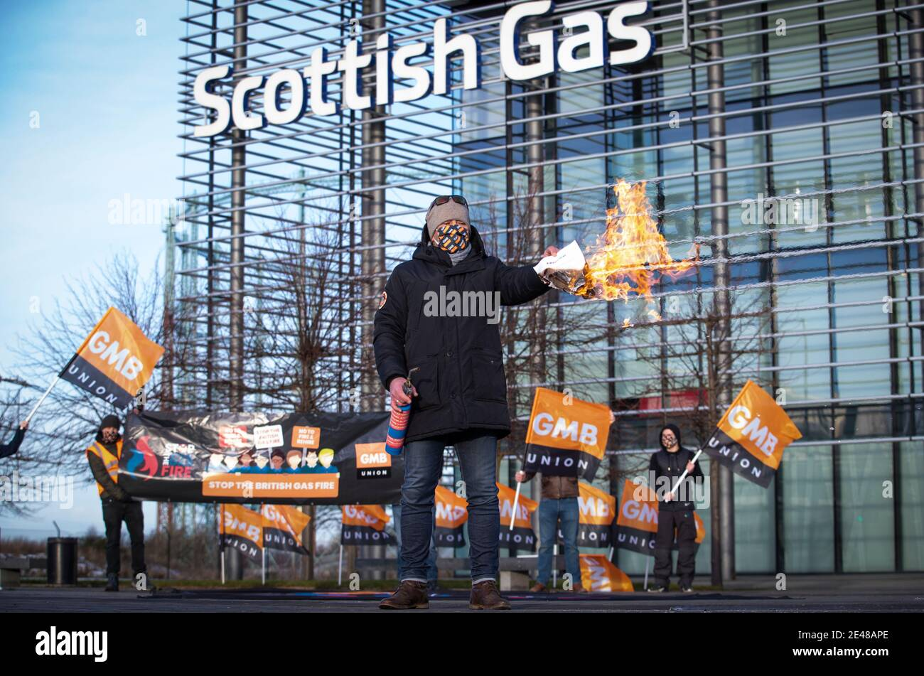 One of the British Gas workers outside the Scottish Gas call centre in Edinburgh sets fire to the new contract on the sixth day of a seven day strike over new contracts. Picture date: Friday January 22, 2021. Stock Photo