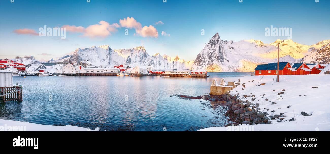 Fantastic winter view on Hamnoy village with port and  Olstinden peak on background.  Location: Hamnoy,  Moskenesoya , Lofoten; Norway, Europe Stock Photo