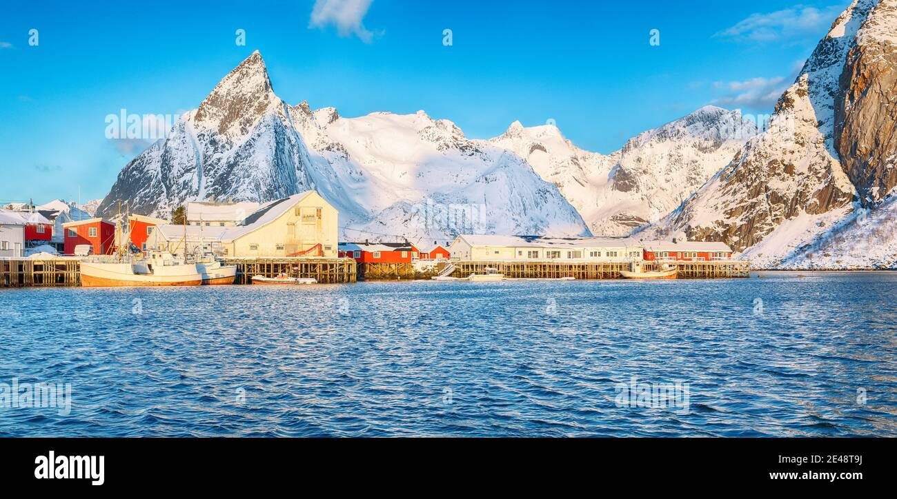Fantastic winter view on Hamnoy village with port and  Olstinden peak on background.  Location: Hamnoy,  Moskenesoya , Lofoten; Norway, Europe Stock Photo