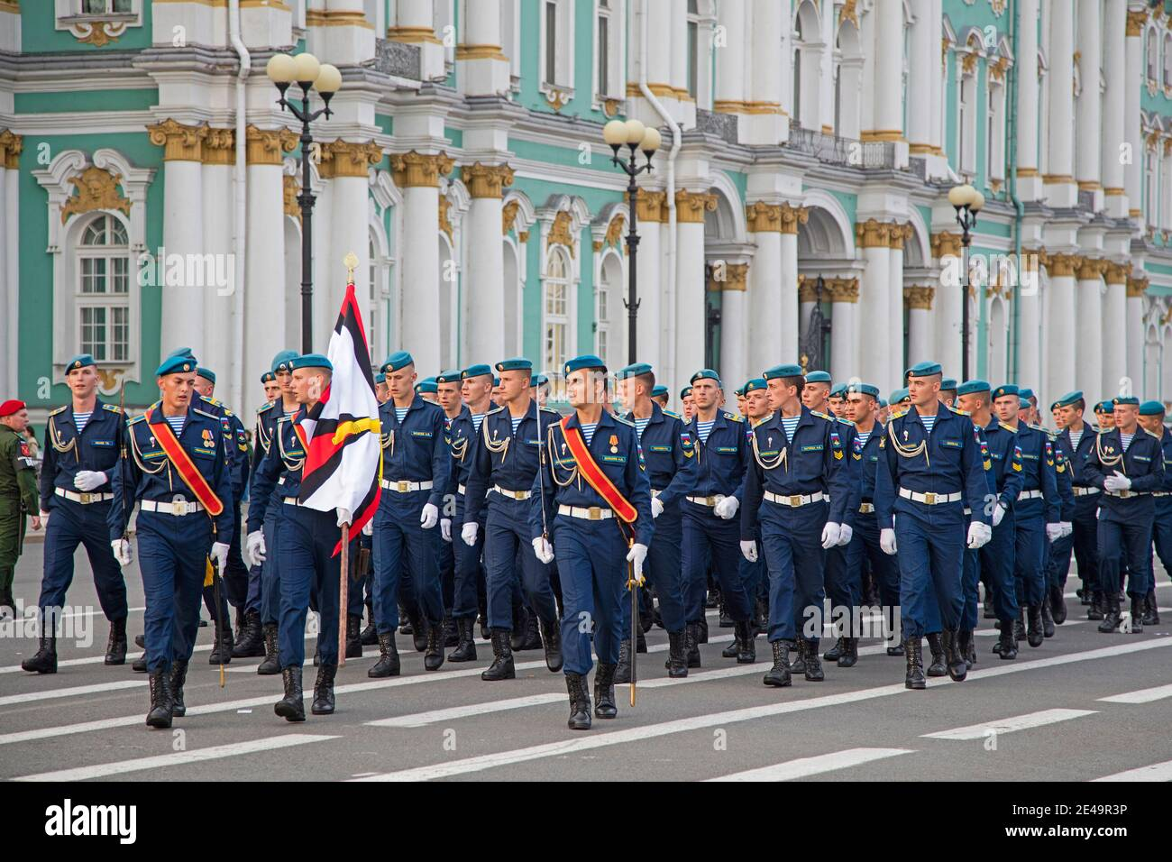 Military parade of Russian Airborne cadets wearing telnyashkas and blue berets marching in front of the Hermitage in Saint Petersburg, Russia Stock Photo