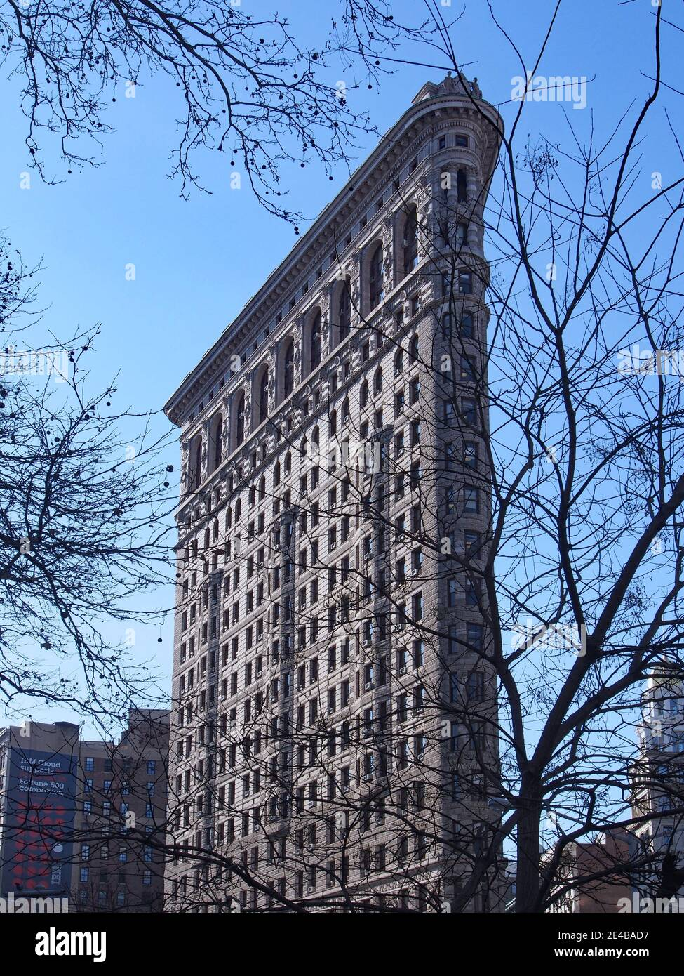 New York City, USA - December 16, 2013:  The narrow end of the iconic Flatiron Building, viewed from Madison Square Park Stock Photo