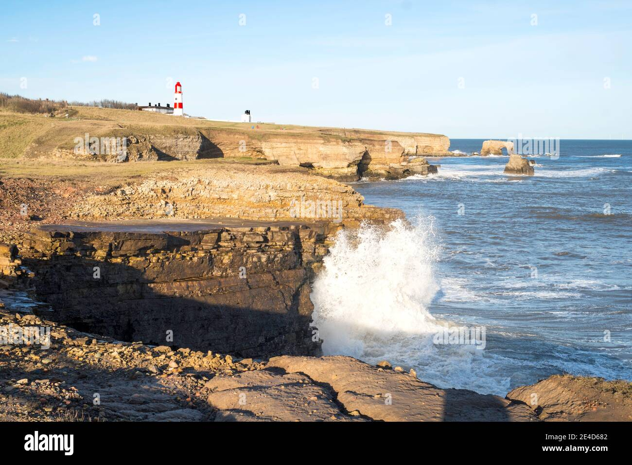 Waves breaking over cliffs south of Souter Point, in Whitburn, north east England, UK Stock Photo
