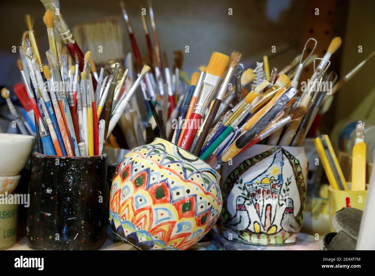 Brushes Used By Palestinians To Paint Ceramic Plates For Sale Are Seen In A Workshop In
