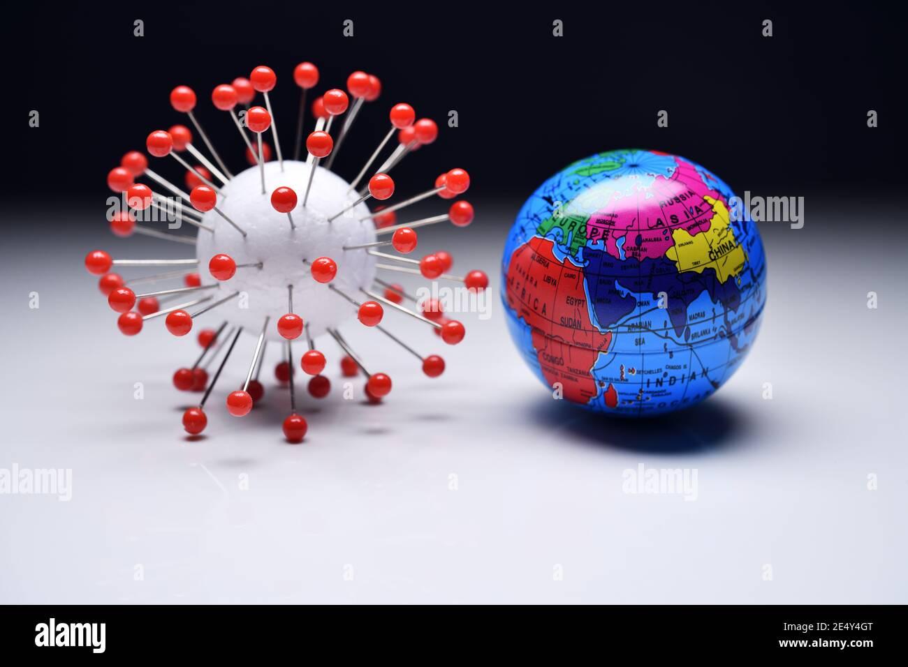 Coronavirus Model And Globe Stock Photo