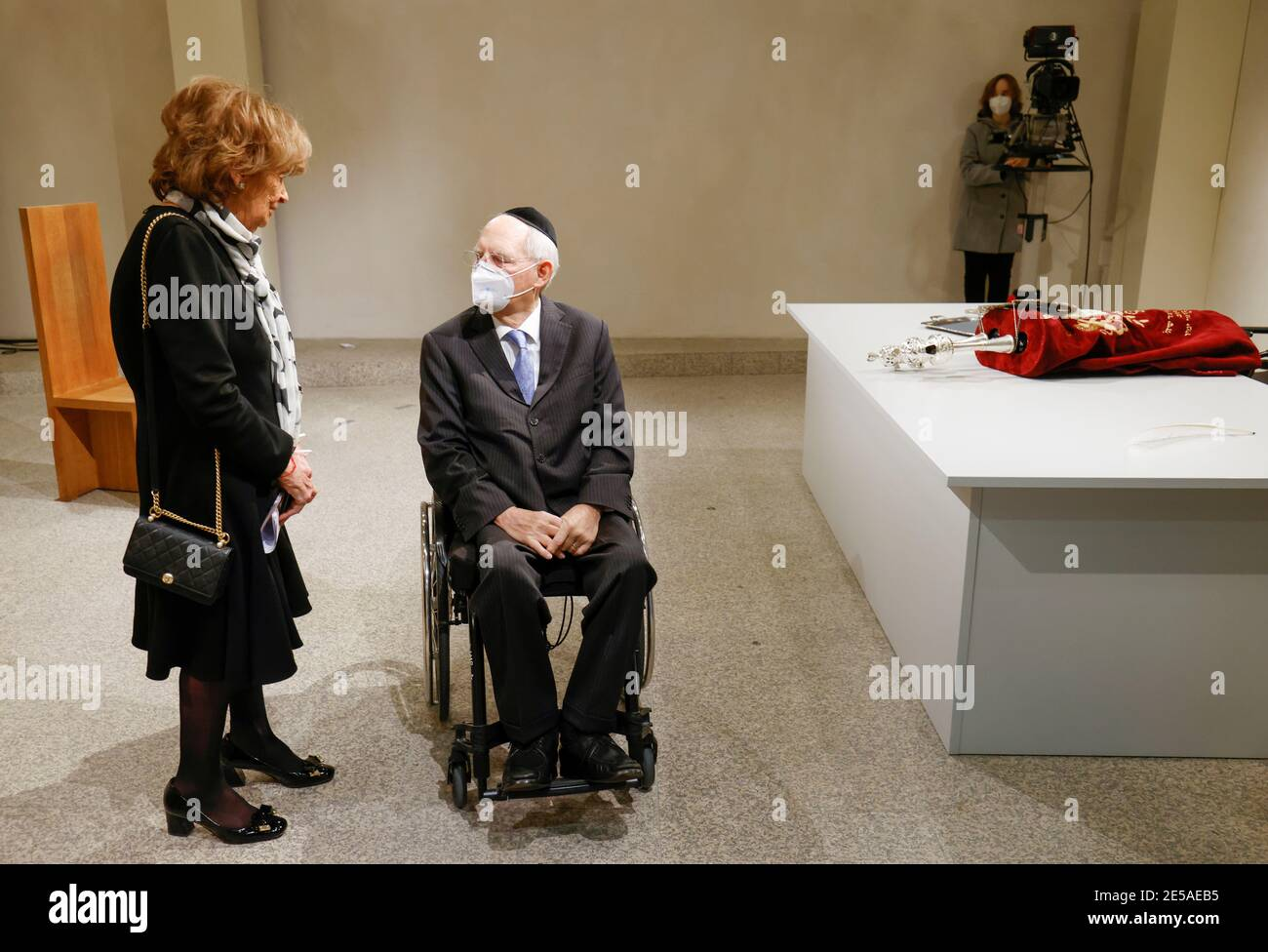 The Vice President of the European Jewish Congress and the World Jewish Congress Charlotte Knobloch and the President of the Bundestag Wolfgang Schaeuble speak next to the historic Sulzbach Torah Scroll (R) from 1792, rediscovered in 2013 and just restored, during a ceremony marking the 76th anniversary of the liberation of Nazi Germany's Auschwitz death camp, on International Holocaust Remembrance Day, at the Bundestag, in Berlin, Germany, January 27 , 2021. Odd Andersen/Pool via REUTERS Stock Photo