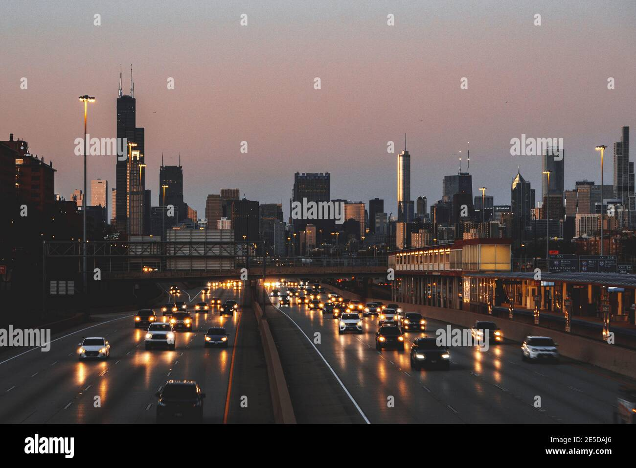 City skyline and cars driving along freeway at sunset, Chicago, Illinois, USA Stock Photo