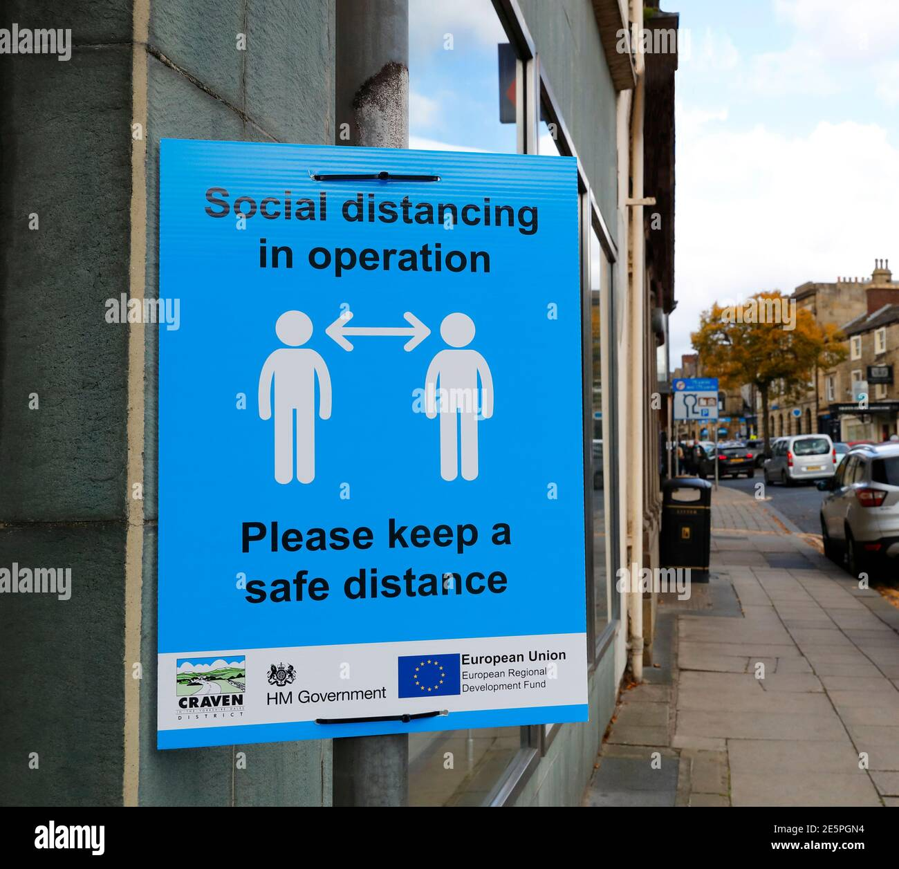 Social distancing information sign in the market town of Skipton North Yorkshire Stock Photo