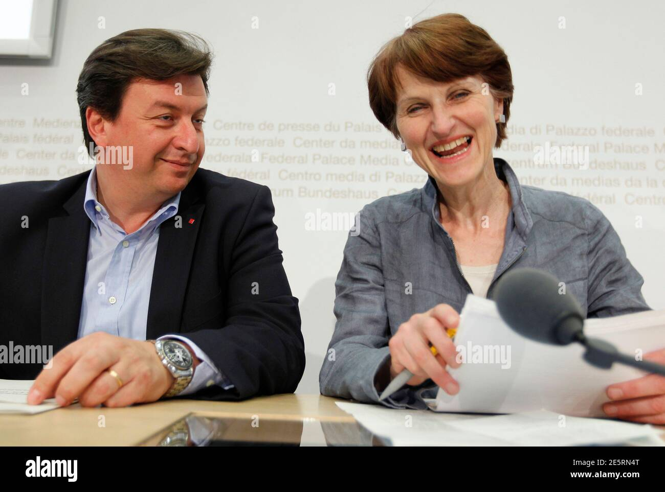 National Councillor Franziska Teuscher (R) and Swiss Construction Workers Union UNIA member Corrado Pardini attend a news conference on the start of the nuclear phaseout initiative in Bern May 19, 2011. REUTERS/Ruben Sprich  (SWITZERLAND - Tags: POLITICS) Stock Photo