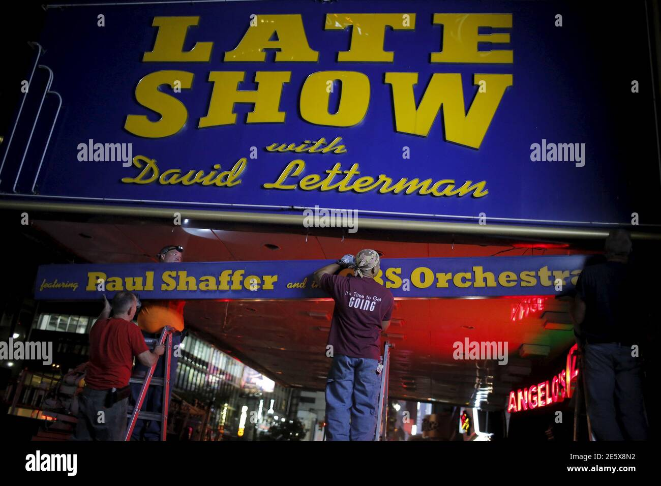 """Workers remove part of the marquee for the """"Late Show with David Letterman"""" outside of the Ed Sullivan Theater in Manhattan, New York May 27, 2015. REUTERS/Eduardo Munoz Stock Photo"""