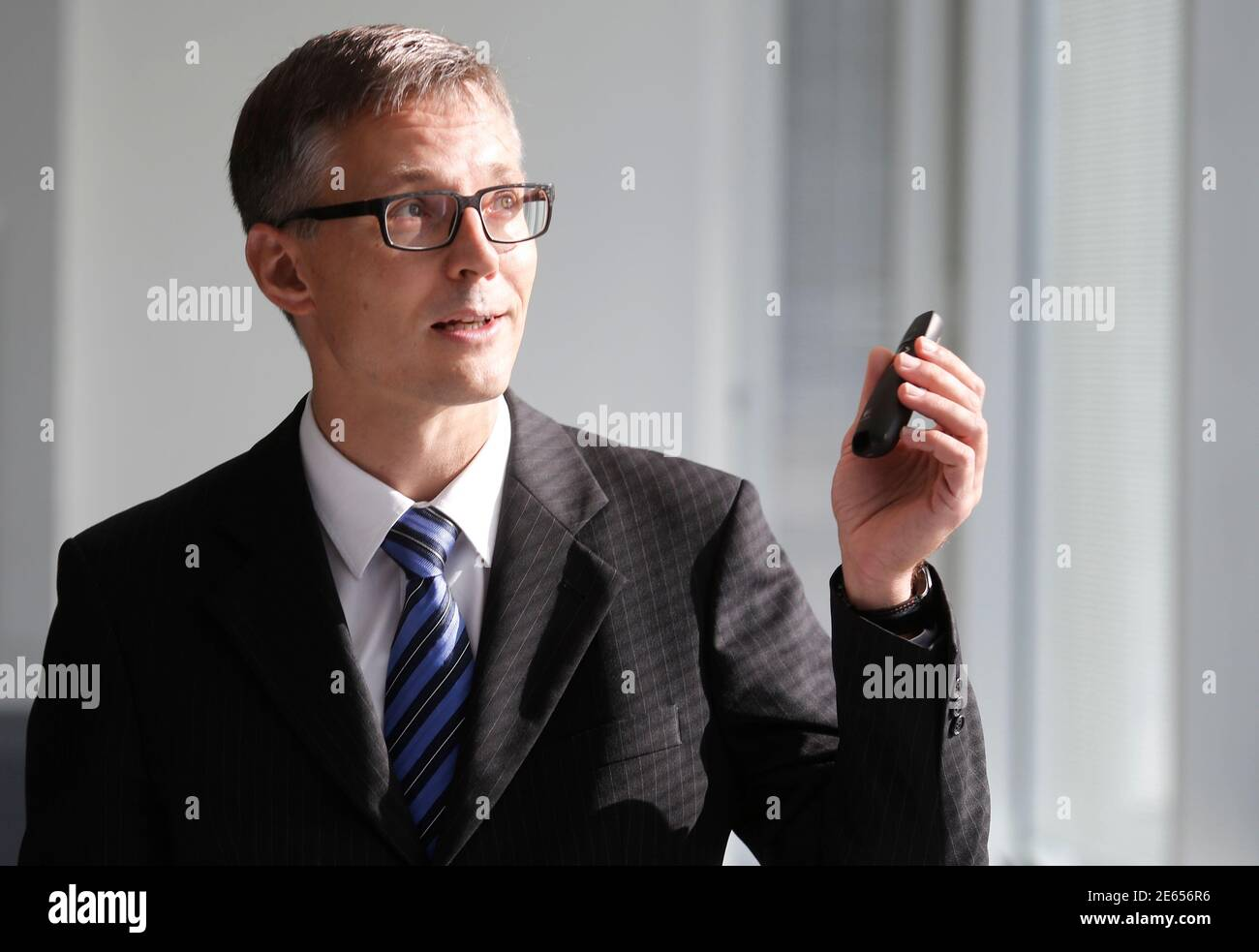Chief Executive Officer (CEO) of Hutchison Whampoa's telecoms unit Drei Austria Jan Trionow addresses a news conference in Vienna September 24, 2014.    REUTERS/Leonhard Foeger (AUSTRIA - Tags: BUSINESS TELECOMS) Stock Photo