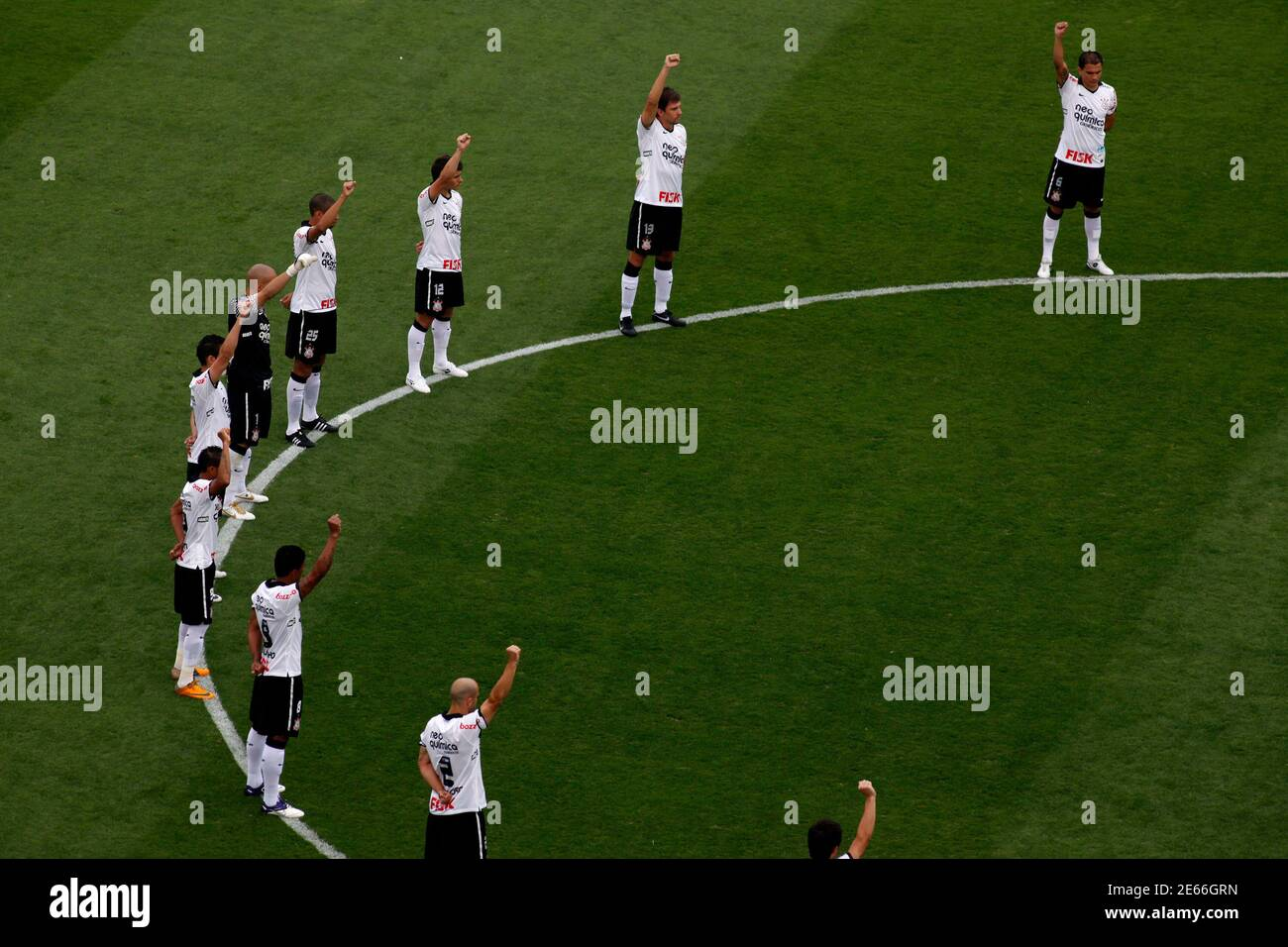 Corinthians soccer players observe a minute's silence for Brazil former soccer player Socrates  before their Brazilian championship against Palmeiras in Sao Paulo December 4, 2011. Brazil 1982 World Cup captain Socrates, the 'Golden Heel' renowned as one of the great playmakers of his generation, died in hospital on Sunday of septic shock at the age of 57, his doctors said in a statement. REUTERS/Nacho Doce (BRAZIL - Tags: SPORT SOCCER OBITUARY) Stock Photo