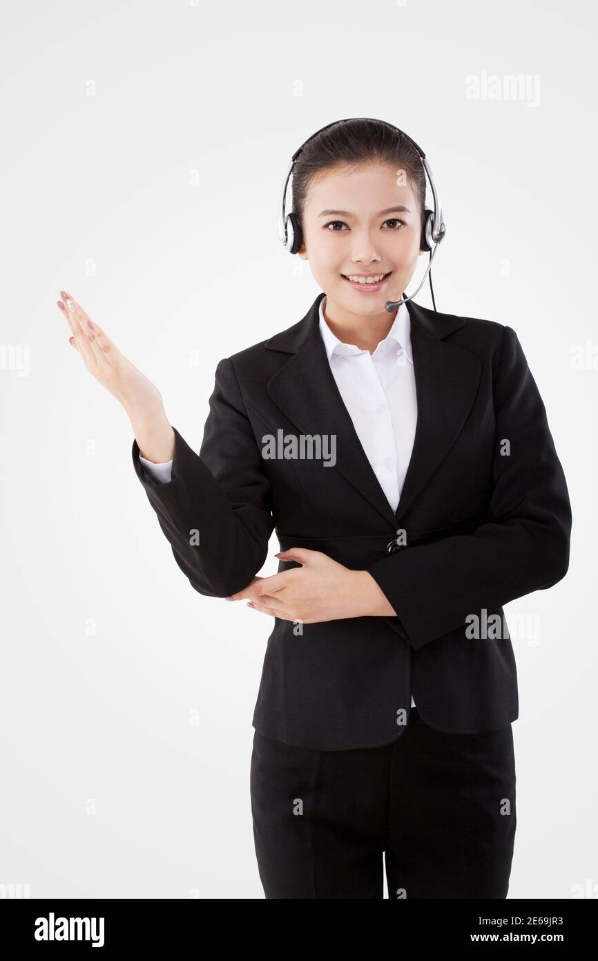 Oriental business lady wearing headset high quality photo Stock Photo