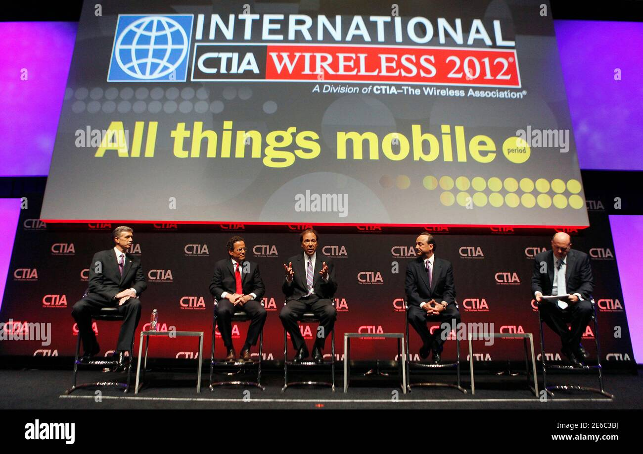 """CNBC's """"Mad Money"""" host Jim Cramer (R) moderates a roundtable discussion with (L- 2nd R) Dan Mead, President and CEO of Verizon Wireless, Philipp Humm, CEO and President of T-Mobile USA, Dan Hesse, CEO of the Sprint Nextel Corporation and Ralph de la Vega, President and CEO of AT&T Mobility during the International CTIA  WIRELESS Conference & Exposition in New Orleans, Louisiana May 8, 2012.  REUTERS/Sean Gardner (UNITED STATES - Tags: SCIENCE TECHNOLOGY BUSINESS MEDIA TELECOMS) Stock Photo"""