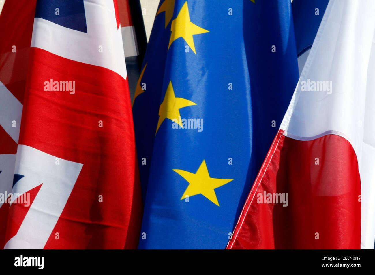 French flag, British Union Jack flag and European flag fly on the Amiens city hall during a Franco-Britain summit in Amiens, northern France, March 3, 2016. REUTERS/Philippe Wojazer Stock Photo