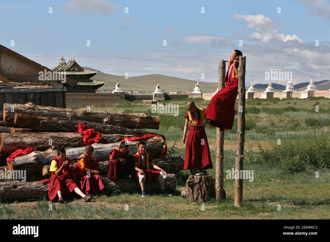 Buddhist monks play at the backyard of the Erdene Zeu monastery in Kharahorin, some 380 km (236 miles) west of Ulan Bator, July 8, 2006. The Erdene Zeu monastery was ransacked during the Stalinist period, and worship was forbidden throughout the Communist era, but Buddhism is experiencing a revival since Mongolia overthrew decades of Soviet dominance in 1991. Stock Photo