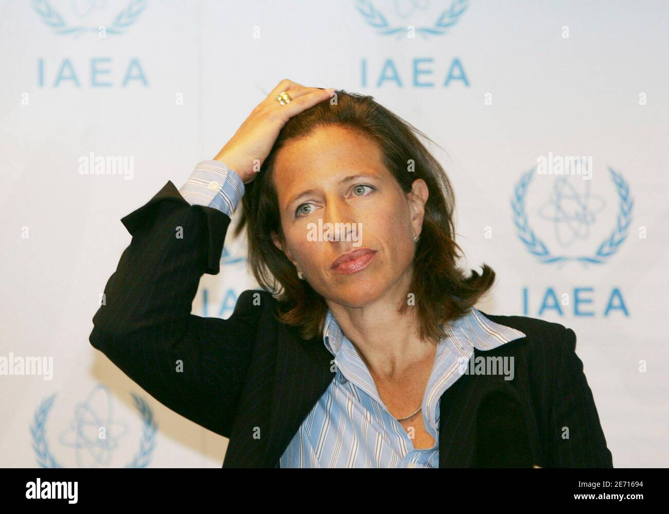 Melissa Fleming, spokeswoman of the International Atomic Energy Agency (IAEA) gestures during a press briefing at IAEA Vienna headquarters August 10, 2005. Iran began breaking U.N. seals at a uranium processing plant on Wednesday, U.N. and Iranian officials said, a step on the road to production of enriched uranium that could be used for nuclear weapons. REUTERS/Leonhard Foeger  LF/CVI Stock Photo