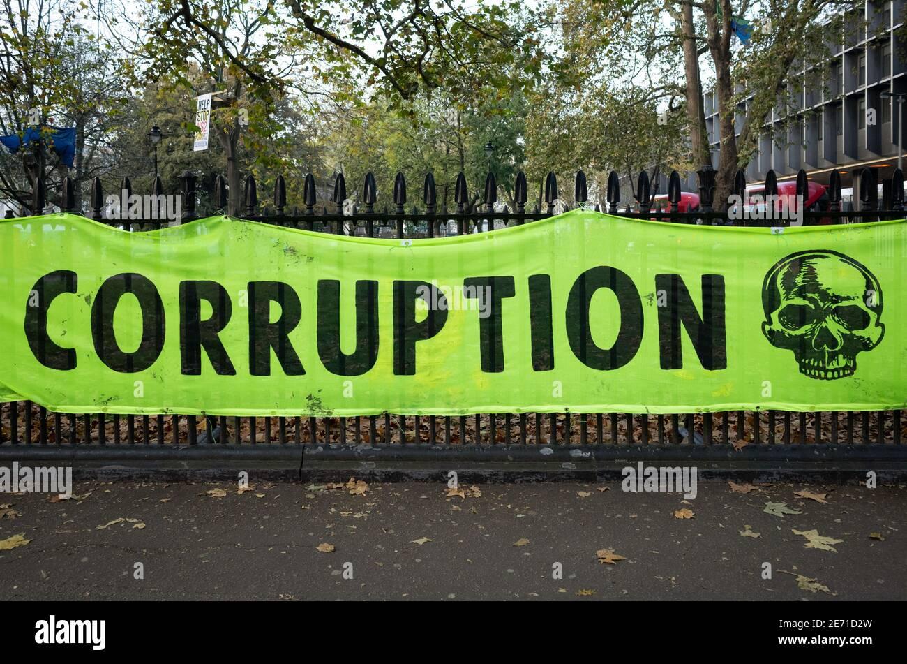 Corruption banner - Anti HS2 protest banner outside Euston train station London. Stock Photo