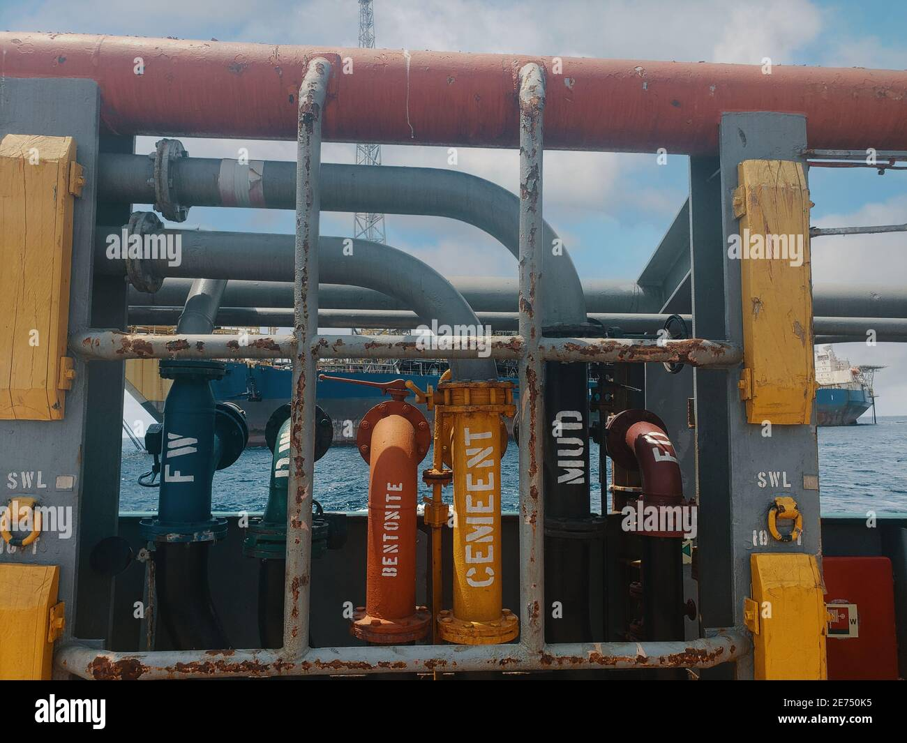 Offshore ship cargo manifolds ready to offload cargo to Floating production storage and offloading FPSO Stock Photo