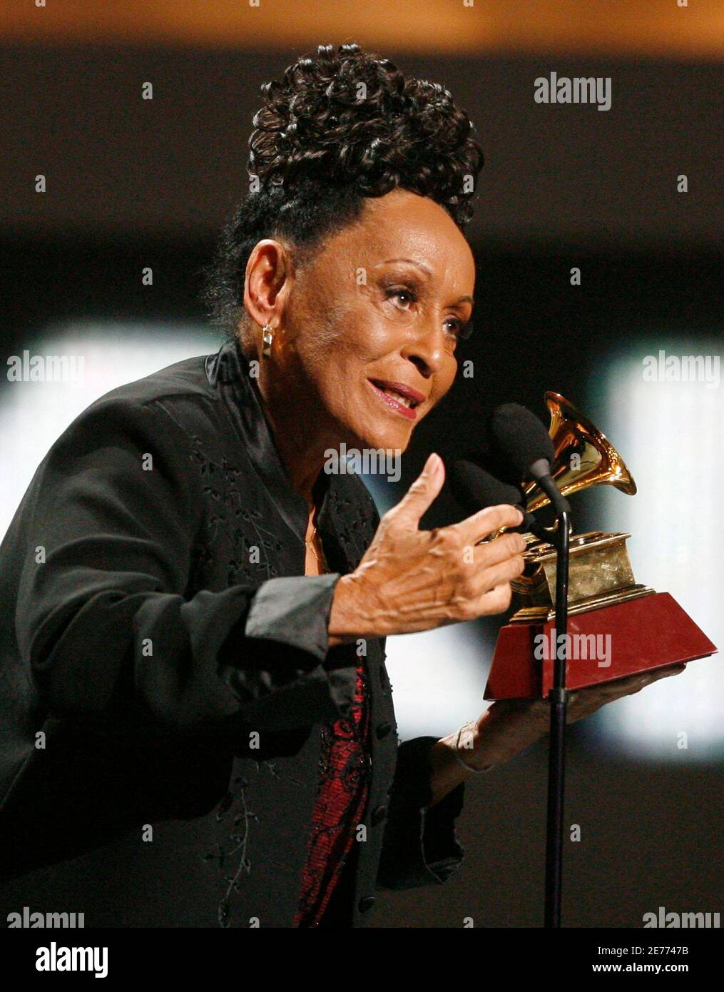 """Cuban singer Omara Portuondo receives her award for Best Contemporary Tropical Album with """"Gracias"""" at the 10th annual Latin Grammy awards in Las Vegas, Nevada in this November 5, 2009 file photo. Cuban musicians such as Portuondo are returning to the United States after a long freeze on such visits, seizing the opportunity of friendlier overtures towards Havana from President Barack Obama.  REUTERS/Mario Anzuoni/Files (UNITED STATES ENTERTAINMENT POLITICS) Stock Photo"""